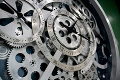 Reloj y engranajes Imágenes de archivo libres de regalías