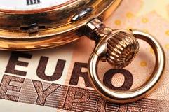 Reloj y euro Imágenes de archivo libres de regalías