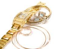 Reloj y joyería de oro Foto de archivo