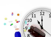 Reloj y píldoras Imagen de archivo libre de regalías
