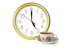 Reloj y té Imagen de archivo libre de regalías
