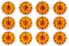 Relojes aislados en el fondo blanco Fotos de archivo libres de regalías