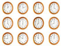 Relojes aislados en el fondo blanco Imagenes de archivo