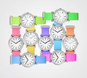Relojes coloridos en fondo gris Imagen de archivo