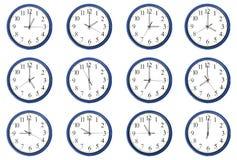 Relojes - día y noche horas Imagen de archivo