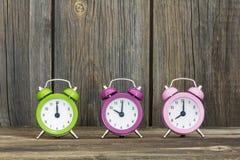Relojes de alarma coloridos Fotografía de archivo libre de regalías