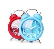 Relojes de alarma en el fondo blanco Fotos de archivo