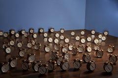 Relojes de alarma en suelo Foto de archivo libre de regalías