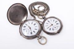 Relojes de bolsillo antiguos en el fondo blanco Fotos de archivo libres de regalías