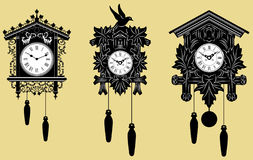 Relojes de cuco fijados ilustración del vector