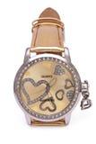 Relojes de oro con los corazones aislados Fotografía de archivo libre de regalías