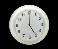 Relojes de pared aislados en negro Foto de archivo libre de regalías