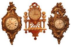 Relojes de pared antiguos con la estructura de madera Imagen de archivo
