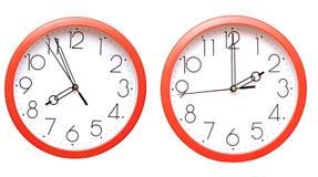 Relojes de pared rojos Imagenes de archivo