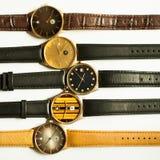 Relojes del vintage en el fondo blanco Fotos de archivo