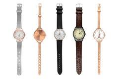 Relojes elegantes de la mujer Fije de cinco relojes femeninos de diversos tamaños y diseños, aislados en el fondo blanco, las tra fotografía de archivo