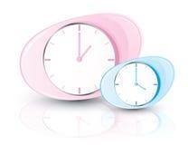 Relojes rosados y azules Imagenes de archivo