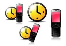 Relojes y teléfono celular Foto de archivo