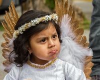 The  reluctant angel with a pout at the Pase de Nino parade Royalty Free Stock Photography