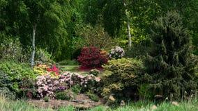 RELVADO DE BARTON, NORFOLK/UK - 23 DE MAIO: Vista de um jardim em Barton Tu Foto de Stock