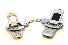 Rely on your cell phone?. Two cell phones cuffed togeter Stock Photo