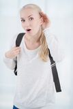 Relying on hand-ear listening young student Stock Image