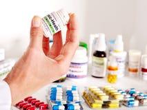 Remède de fixation de main. Photographie stock