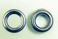 Remaches del agujero en una óptica retra del fondo ligero fotografía de archivo libre de regalías