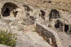 Remain of the ancient rock cave city of Uplistsikhe. Georgia Stock Image