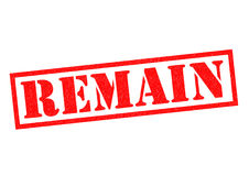 REMAIN. Red Rubber Stamp over a white background Royalty Free Stock Photo