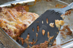 Remainder of a baking tray of lasagne. Leftovers of bolognese style lasagne in a glass bowl Royalty Free Stock Photos