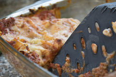 Remainder of a baking tray of lasagne. Leftovers of bolognese style lasagne in a glass bowl Stock Photos
