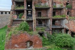 Remained only some internal walls. SHLISSELBURG, SAINT PETERSBURG, RUSSIA - AUGUST 21, 2017: the Views of Wardens and prison housing 1911. of the Oreshek stock photography