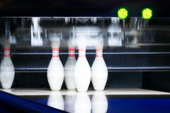 5 remaining bowling pins after the first throw, background night light royalty free stock images