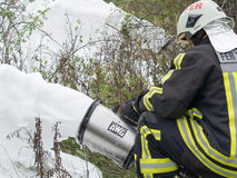 The remaining foam fluid evacuation. Szeged, Algyo, Hungary - October 8, 2015: Regional fire-fighting exercise in the training area with urban and contract Stock Photography
