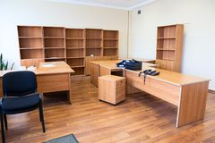 Remaining furniture as tables and cabinets in empty office after the tenant`s eviction. Remaining furniture as tables and cabinets are in empty office after the royalty free stock images