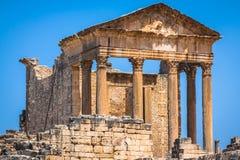 Remaining of the roman City of Dougga with the Capitol, Tunisia Stock Photos