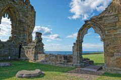 Remainings of Whitby Abbey in North Yorkshire in the UK. It is ruins of the Benedictine abbey. Now it is under protection of the English Heritage Royalty Free Stock Photography