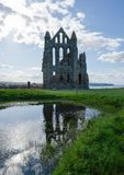 Remainings of Whitby Abbey North Yorkshire the UK. Remainings of Whitby Abbey in North Yorkshire, the UK. It is ruins of the Benedictine abbey. Now it is under Royalty Free Stock Photos