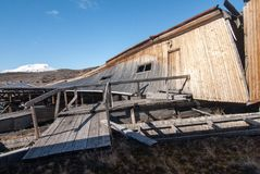 Remainings of wooden buildings that were used to shelter the entrance to coal mines in the Soviet/ Russian ghost town Pyramiden in Royalty Free Stock Images