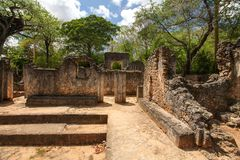 Remains of ancient african city Gede Gedi in Watamu, Kenya wit. H trees and sky in background stock image