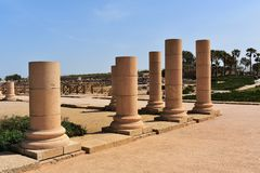 Remains of ancient columns from the Roman period in Caesarea, Israel. Caesarea was a Roman city named after the Caesar and built by King Herod the Great royalty free stock photos