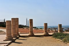 Remains of ancient columns from the Roman period in Caesarea, Israel. Caesarea was a Roman city named after the Caesar and built by King Herod the Great stock photography