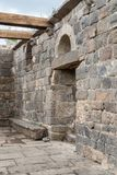 Remains of an ancient synagogue in the ruins of ancient Jewish settlement Umm el Kanatir - Mother  Arches on the Golan Heights. Remains of an ancient synagogue Royalty Free Stock Photography