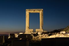 The remains of the ancient temple of Delian Apollo at Naxos, Greece. The remains of the ancient temple of Delian Apollo, also called Portara, at dusk, at Naxos royalty free stock images