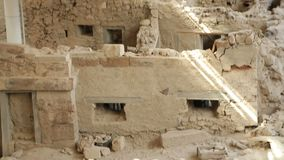 Remains of ancient village of Akrotiri under excavation, vertical panorama view. Stock footage stock video