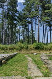 Remains of antiquity in the green forest near by castle Hisarlak. Kiustendil town, Bulgaria Royalty Free Stock Photos