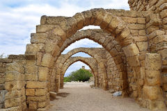 Remains of the archs in ancient city of Caesarea, Israel. Remains of the archs over the main streets of the ancient city of Caesarea, built by the Crusaders Stock Photos