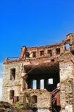 Remains av ett hus efter ett jordskalv royaltyfri fotografi