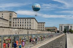Remains of Berlin Wall and Welt Balloon. BERLIN, GERMANY - JULY 24: Remains of Berlin Wall and Welt Balloon that takes tourists 150 meters into the air above the Stock Photography